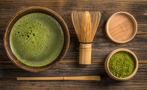 51629549 - top view of green tea matcha in a bowl on wooden surface